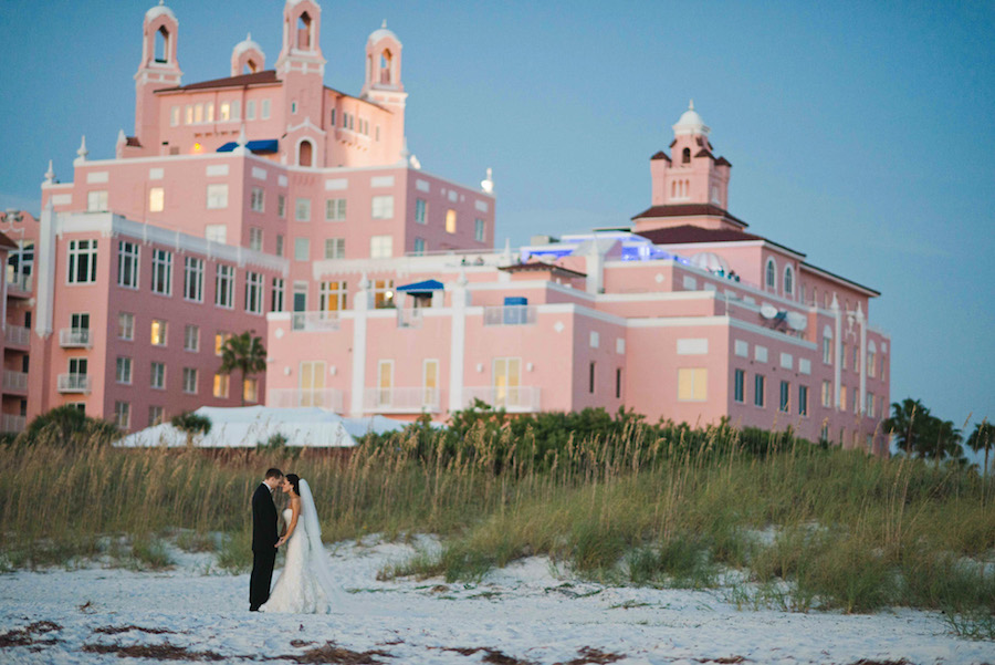Outdoor, Florida Beach Waterfront Bride and Groom Wedding Portrait at Tampa Wedding Venue Loews Don CeSar Hotel   Tampa Wedding Photographer Marc Edwards Photographs