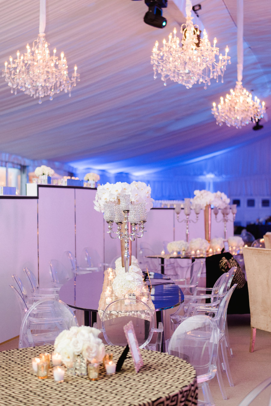 Wedding Reception Decor with White Floral Centerpieces on Gold Specialty Linen with Crystal Chandeliers and Lucite Chairs | Flowers by Andrea Layne Floral Design | Linens by Connie Duglin Linens | Downtown Tampa Wedding Photography by Ailyn La Torre Photography