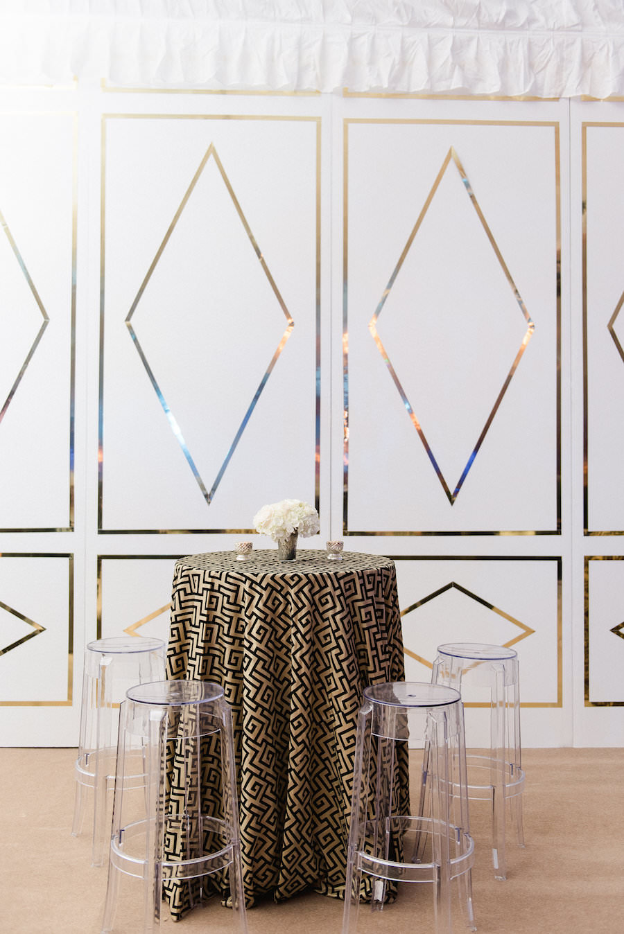 Great Gatsby 1920s Inspired Wedding Reception Inspiration | Gold Sequined Linens with White and Gold Walls and Ghost Chairs
