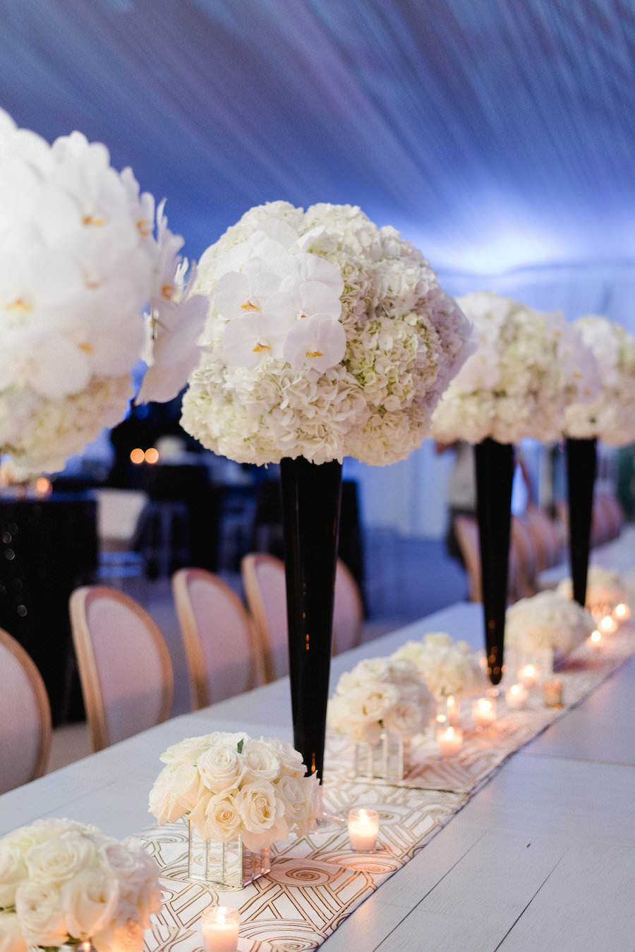 Wedding Reception Décor with Tall, White Hydrangea and Orchid Centerpieces with Black Vases on Long, White Feasting Tables | Wedding Flowers by Andrea Layne Floral Design | Downtown Tampa Wedding Photographer Ailyn La Torre Photography