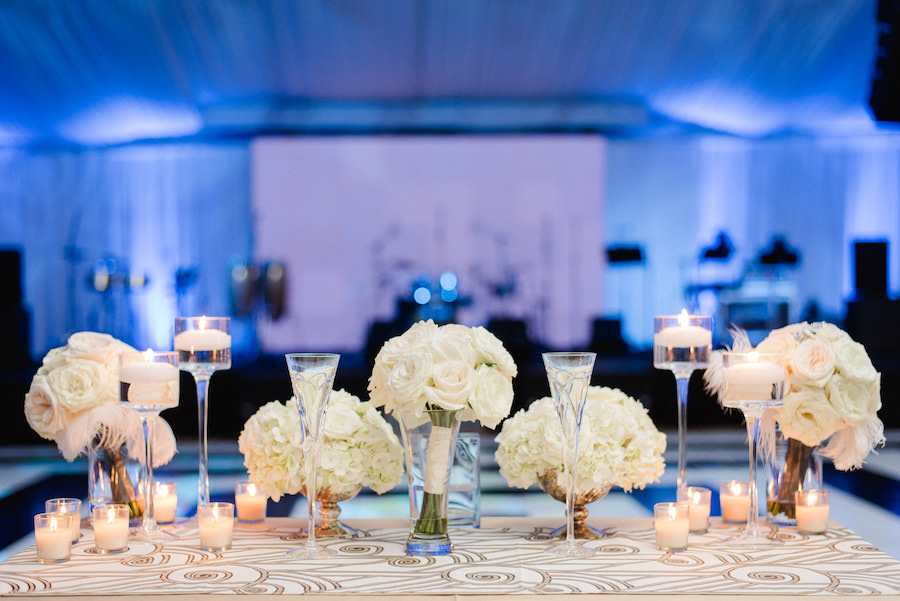 Elegant Wedding Reception Head Table Decor with White Rose and Hydrangea Centerpieces by Downtown Tampa Wedding Florist Andrea Layne Floral Design | Photography by Ailyn La Torre Photography