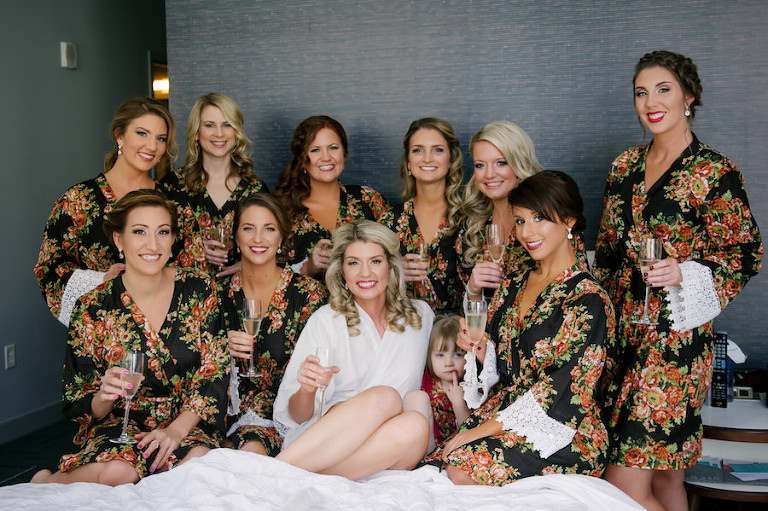 Bridesmaids Getting Ready Wedding Day Portrait in Black Floral and Lace Robes with Champagne