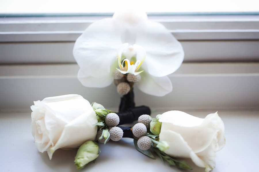 White Orchid and Rose Boutonnieres with Grey Brunia Berries   St. Petersburg Wedding Photographer Limelight Photography