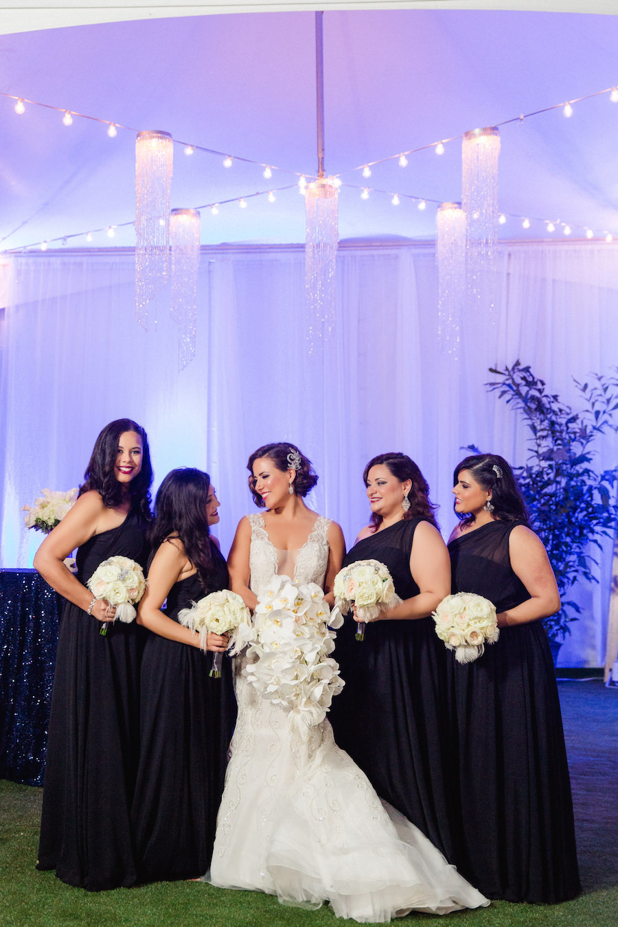 Bridal Party Wedding Portrait in Black One Shoulder Bridesmaids Dresses and Ines Di Santo Sleeveless Mermaid Wedding Dress from Isabel O'Neil Bridal with Ivory Floral Bouquets by Downtown Tampa Wedding Florist Andrea Layne Floral Design | Photography by Ailyn La Torre Photography