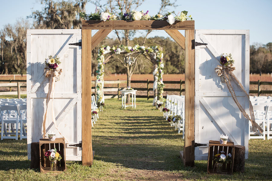 Outdoor, Plant City Wedding Ceremony with Wooden Doors and White, Yellow, and Purple Floral Decor