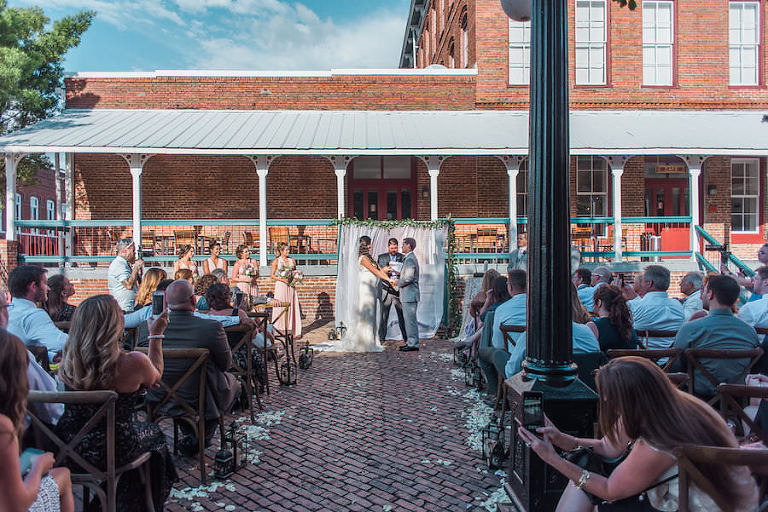 Rustic Outdoor Wedding Ceremony in Downtown Tampa Wedding Venue CL Space with Wooden Ceremony Chairs | Chair Rentals by A Chair Affair