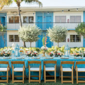 Outdoor, St. Petersburg Wedding Reception Table Decor with Wooden Chairs, Blue Table Linens, and Peach and Ivory Floral Wedding Centerpieces and Blue Lanterns | St. Petersburg Linens by Connie Duglin Linens | St. Petersburg Wedding Photographers Caroline and Evan Photography