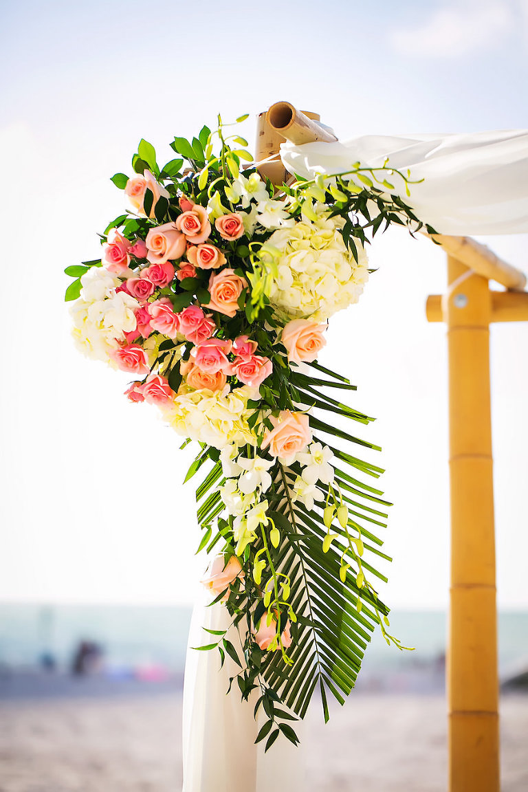 Pink, Coral, and Ivory Ceremony Flowers on Bamboo Wedding Altar | Clearwater Wedding Florist Iza's Flowers