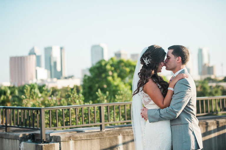 Downtown Tampa Bride and Groom Outdoor Wedding Portrait with Tampa Skyline at Wedding Venue CL Space | Bridal Hair and Makeup by Michele Renee The Studio