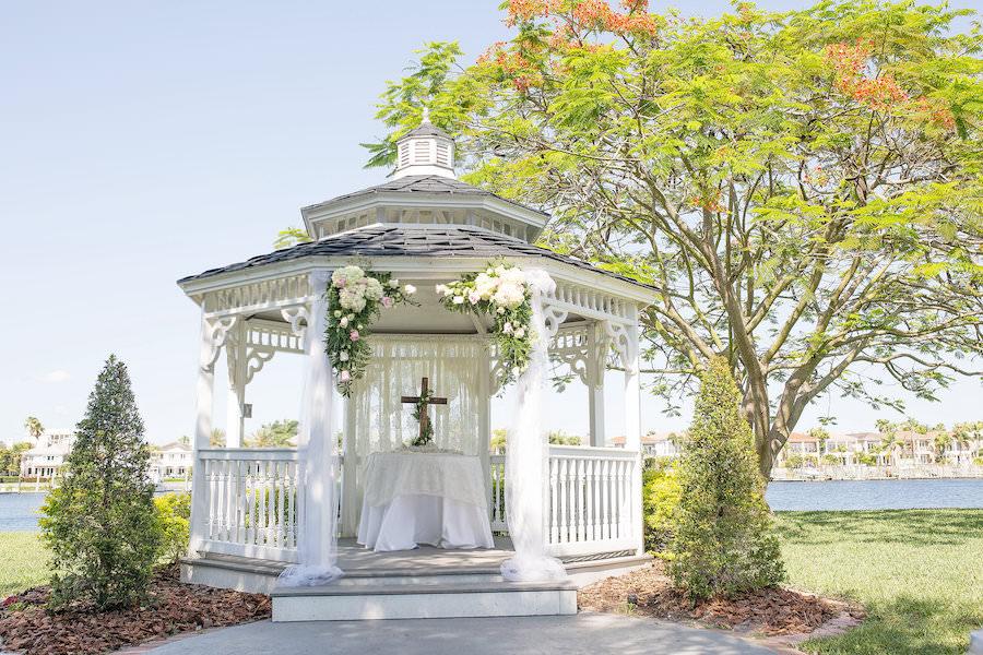 White Gazebo at Outdoor, Garden Wedding Ceremony with Pink and White Floral Decor and Wooden Cross | Davis Island Garden Club Wedding