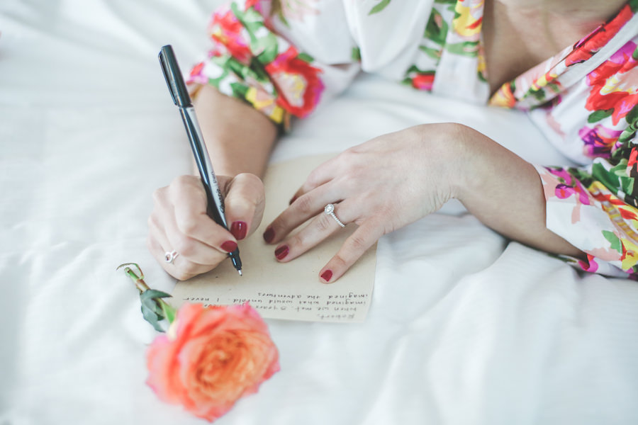Bride Writing Groom Letter on Wedding Day