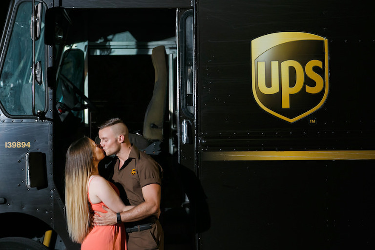 Tampa Couple Engagement Portrait Outside UPS Truck | Fiancé Works For UPS Engagement Shoot | Unique Engagement Session Ideas | Tampa Fl Wedding Photographer Carrie Wildes Photography