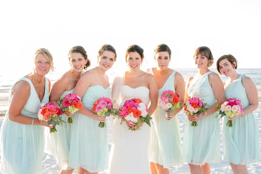 Bride and Bridesmaids Waterfront, Beach Wedding Portrait with Blue Bridesmaids Dresses and Colorful Bouquets