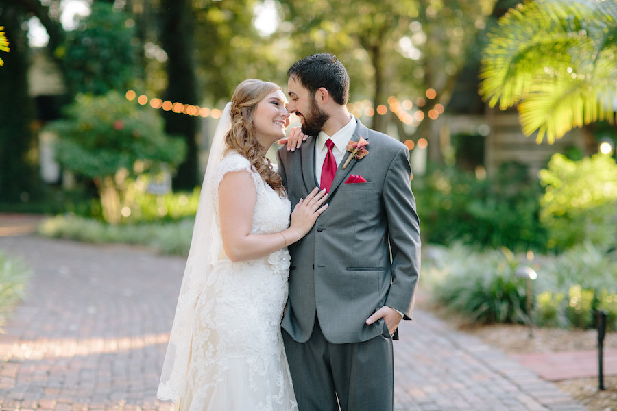 Outdoor, Bride and Groom Wedding Portrait in Grey Groom's Suit and Ivory, Lace Maggie Sottero Wedding Dress