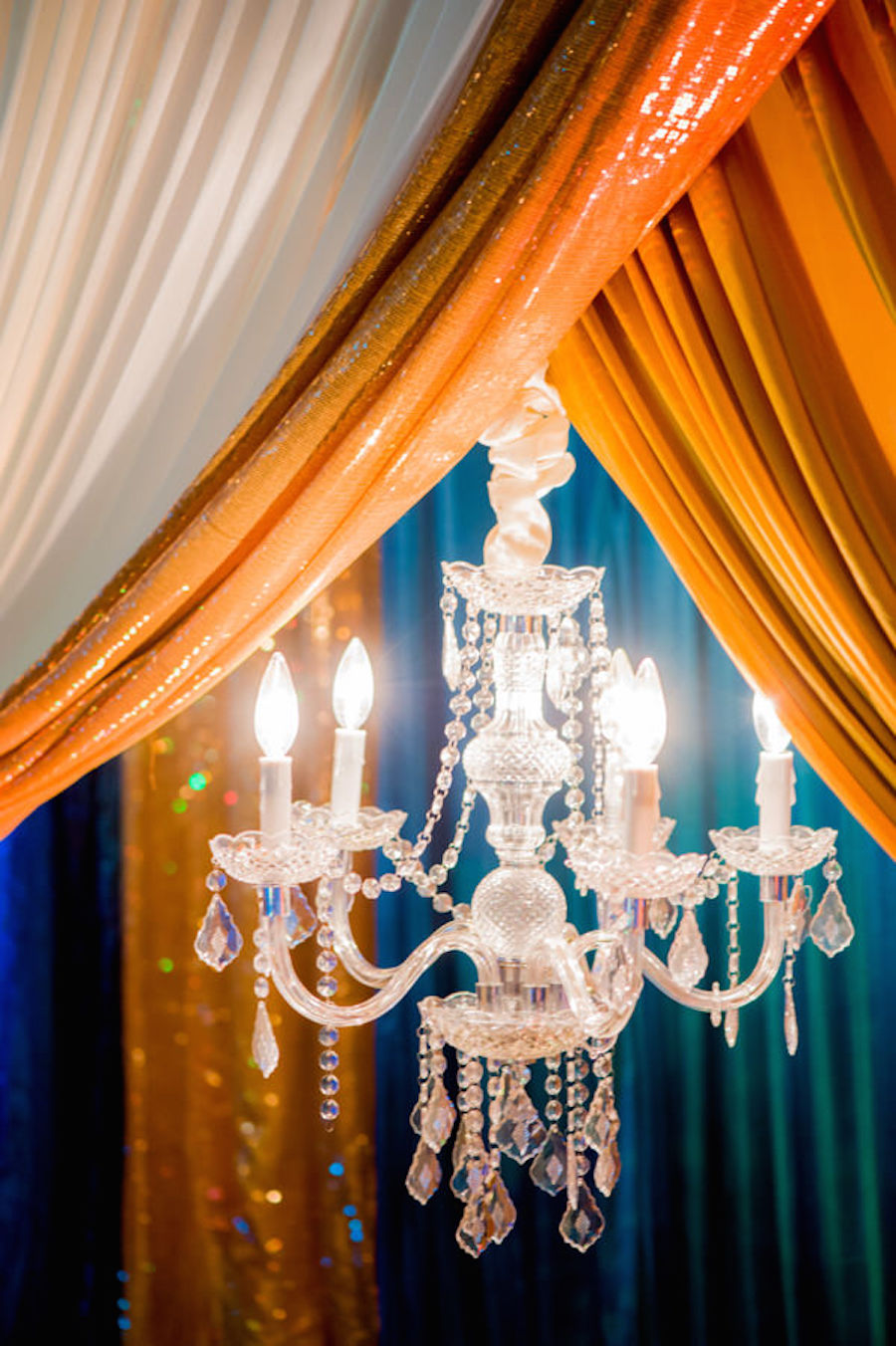 Crystal Chandelier Decor at Tampa Bay Indian Wedding with Teal and Gold Draping at The Palmetto Club at Fishhawk Ranch