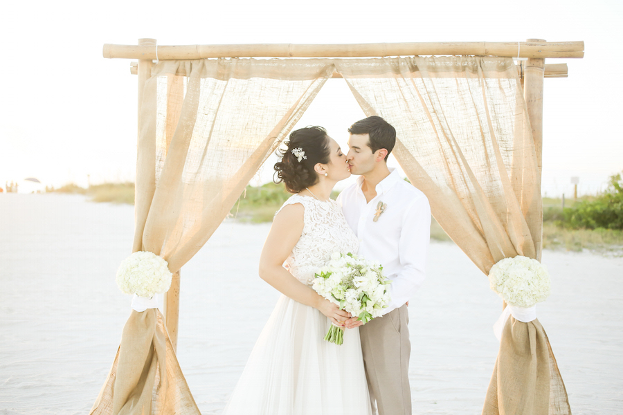 Florida Beach Wedding Ceremony Arch with Bamboo Posts and Burlap Fabric Accent by Tampa Wedding Planner UNIQUE Weddings and Events