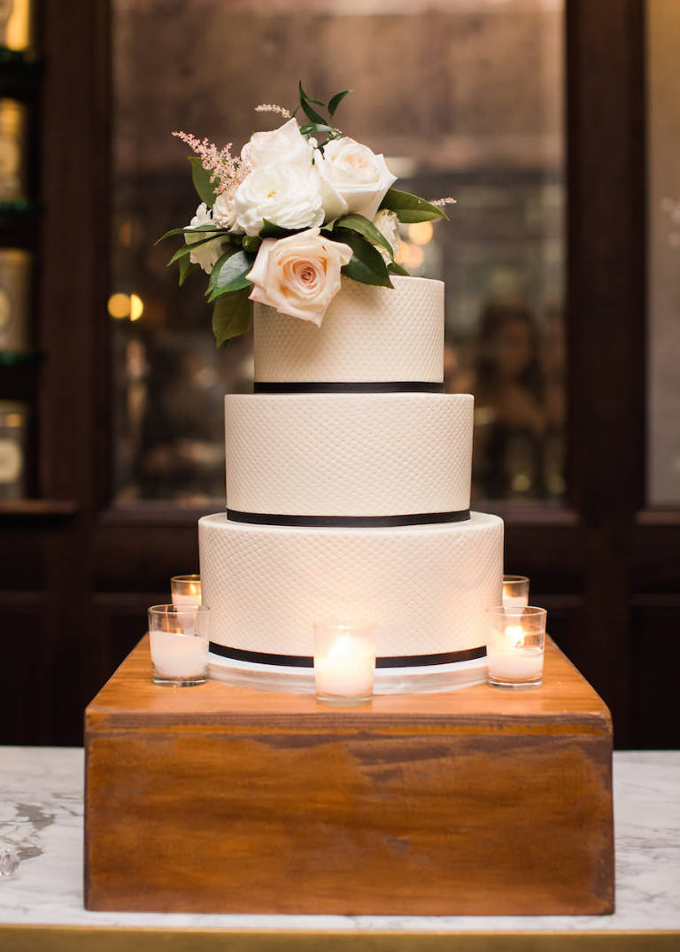 Three Tiered White Textured Round Wedding Cake with Black Ribbon Accent and Fresh Ivory and Pink Rose Caketopper | Tampa Wedding Cakes and Desserts Hands on Sweets