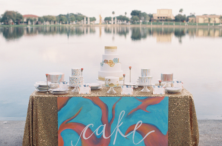 Wedding Cake Dessert Table with Gold Sequin Tablecloth and Assorted Round Wedding Cakes | Tampa Wedding Cakes and Desserts Hands on Sweets