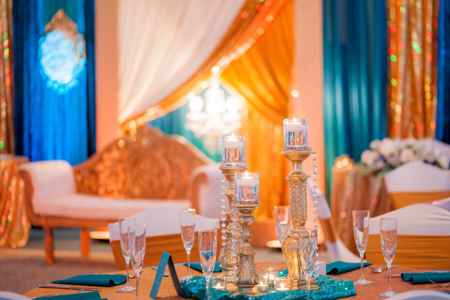 Glamorous Indian Wedding Reception with Gold and Teal Décor with Candelabra Centerpieces and Sparkly Gold Draping at Tampa Bay Wedding Venue, The Palmetto Club at Fishhawk Ranch