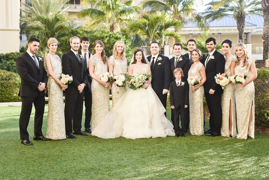 Outdoor, Clearwater Beach Bridal Party Wedding Portrait | Gold Sequin Bridesmaid Dresses and Ivory Halter Neck Hayley Paige Wedding Dress with Beaded Bodice and Horse Hair Skirt and Ivory Wedding Bouquet with Greenery | Wedding Hair and Makeup Artist Michele Renee The Studio