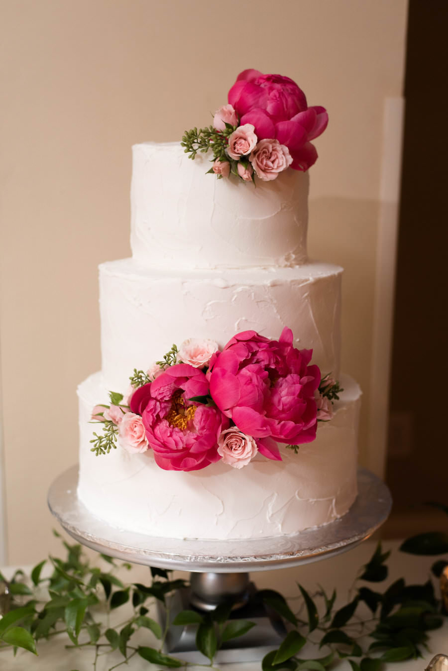 Three-Tiered, Round, White Wedding Cake with Pink Peony Wedding Accents