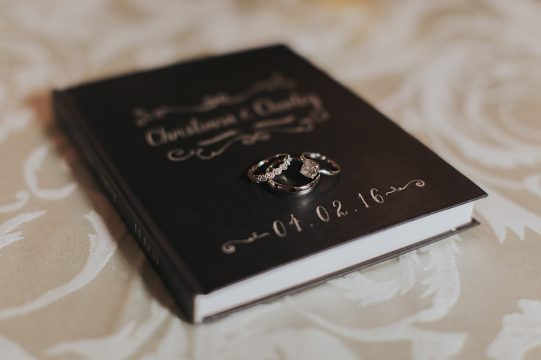 Bride and Groom Wedding Bands and Engagement Rings on Guest Book