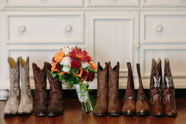 Bride and Bridesmaids Cowgirl Boots for Rustic Wedding and Orange and Red Bridal Bouquet