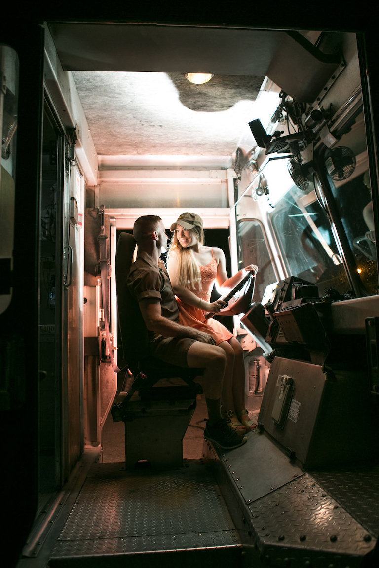 Fun and Playful Engagement Portrait Inside UPS Truck | Fiancé Works For UPS Engagement Shoot | Unique Engagement Session Ideas | Tampa Fl Wedding Photographer Carrie Wildes Photography