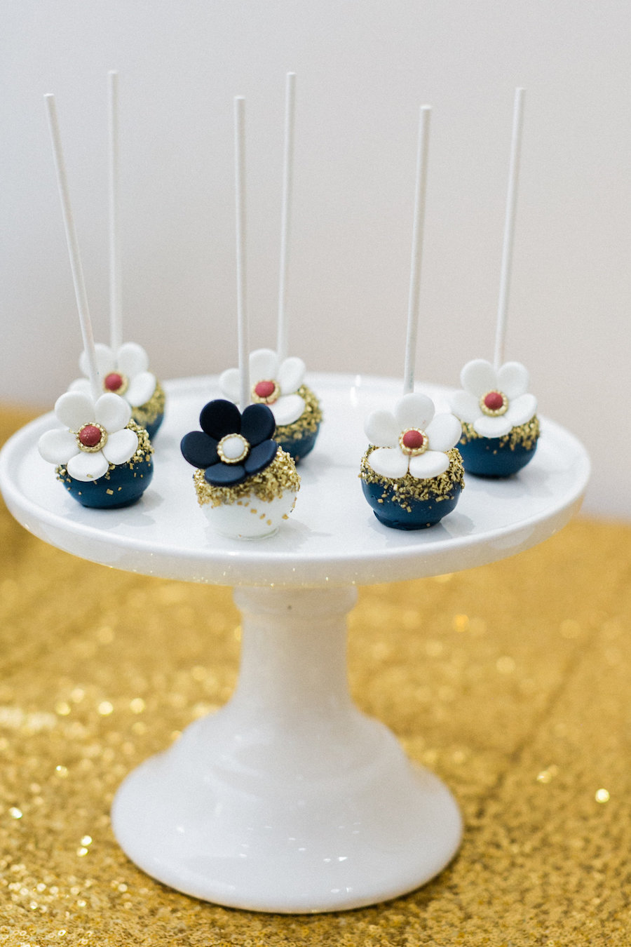 Tampa Wedding Cakepops with White, Navy and Gold Floral Design by Sweetly Dipped Confections   Wedding Dessert Table Favorites on Gold Sequin Linen