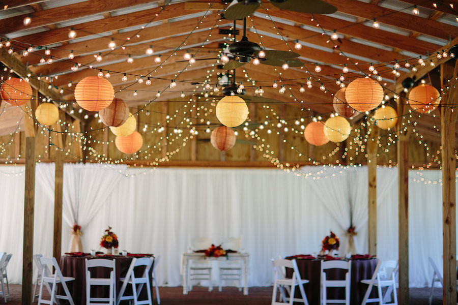 Indoor, Rustic, Dover Barn Wedding Reception Decor with Paper Lanterns and String Lighting