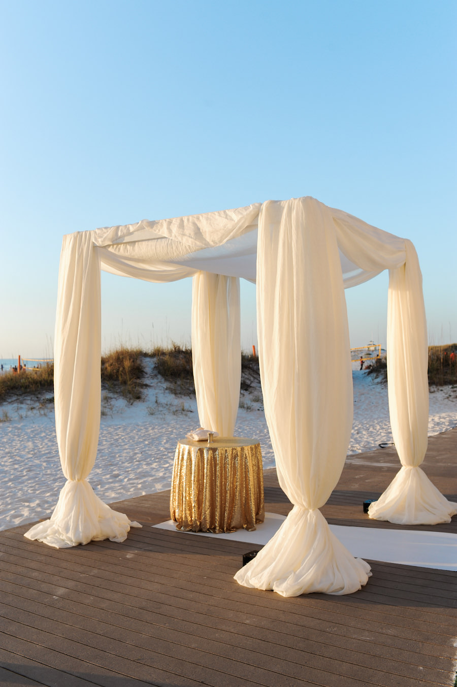 Jewish Beach Wedding Ceremony in Clearwater Beach, Fl Under White Chuppah with Gold Specialty Linen