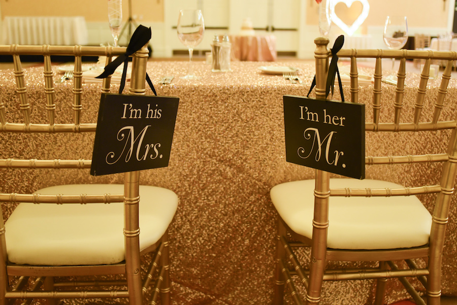 """Bride and Groom Head Table Chair Signs """"I'm His Mrs."""" and """"I'm Her Mr."""" on Gold Chiavari Chairs"""