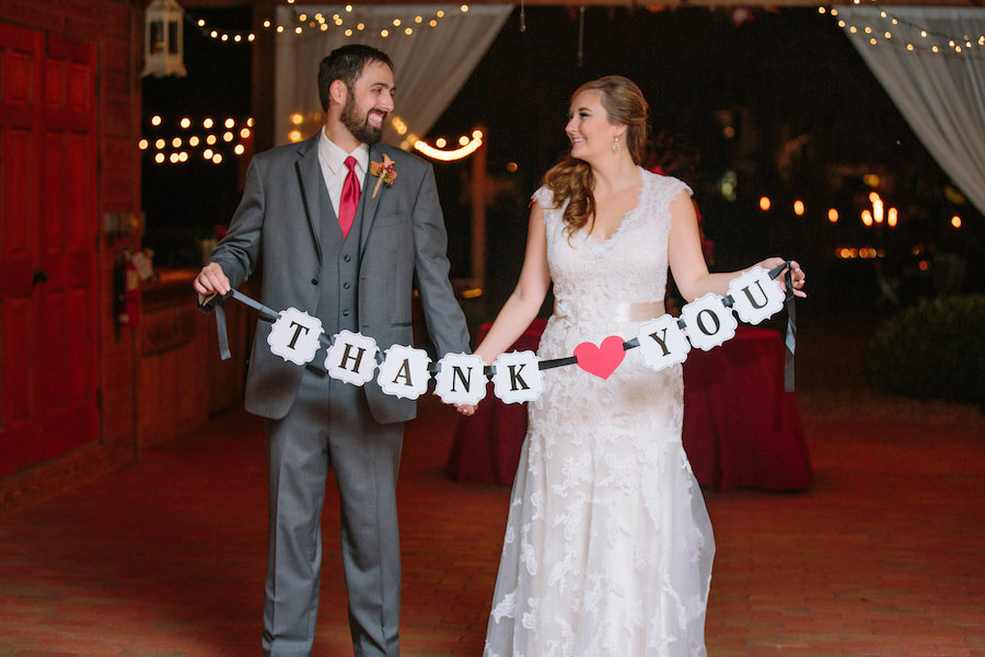 Bride and Groom Holding Thank You Sign at Dover Wedding Reception