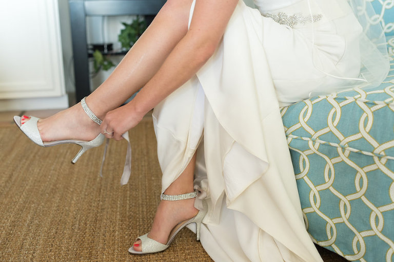 Bride Putting on Silver, Wedding Shoes with Ankle Straps