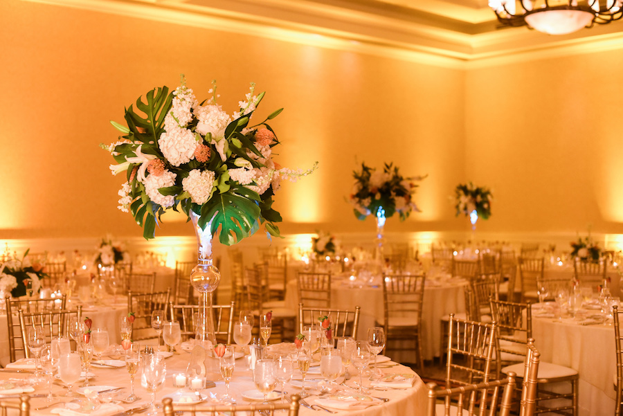 Elegant Clearwater Beach Wedding Reception with Gold, Ivory, Green and Coral Tall Centerpieces | Lighting by Nature Coast Entertainment Services