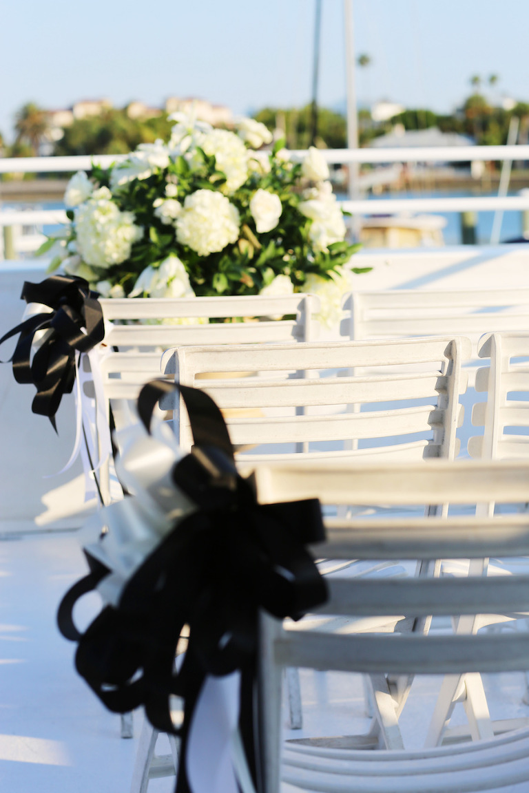 Clearwater Wedding Venue Yacht Starship Sensation Ceremony with White Chairs and White Floral Arrangements