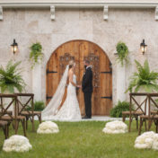 Southern Inspired Wedding Bride and Groom Outdoor Wedding Ceremony Portrait in Black Tuxedo and Ivory Strapless Trumpet Wedding Dress | Sarasota Wedding Venue Bakers Ranch