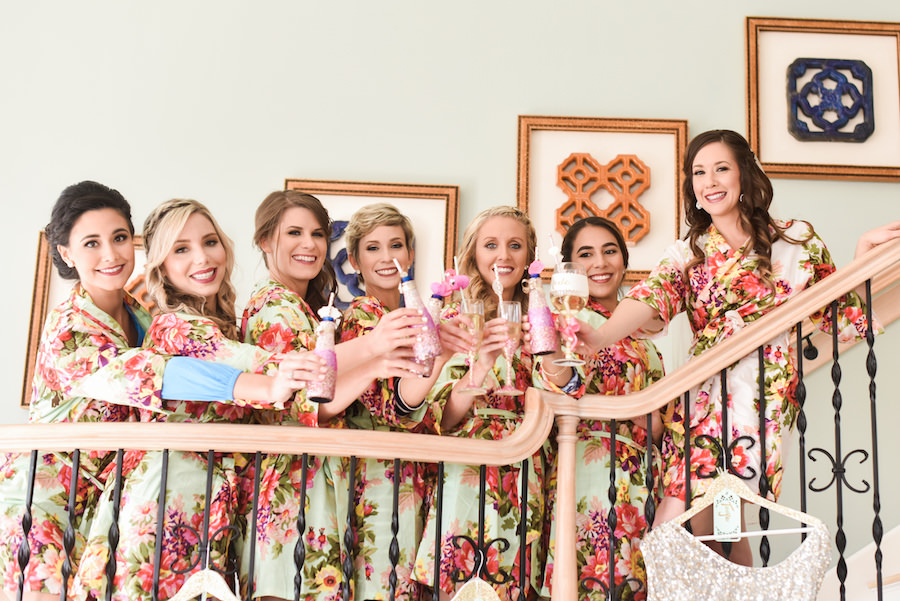 Bridesmaids Getting Ready Photo in Matching Floral Robes and Champagne Flutes Wedding Portrait