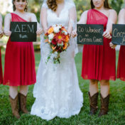 Bride and Bridesmaids Dover Wedding Portrait with Signs of How They Met in Red Bridesmaids Dresses and Cowgirl Boots