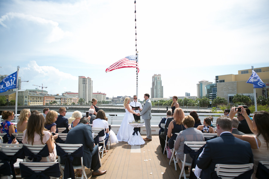 Bride and Groom Exchanging Vows at Tampa Waterfront Wedding Ceremony on the Yacht Starship Sensation | Tampa Wedding Photographer Carrie Wides Photography