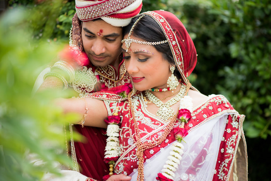 Outdoor Tampa Bay Indian Bride and Groom Wedding Portrait in Red, White and Gold Bridal Panetar at The Palmetto Club at Fishhawk Ranch Wedding Venue   Wedding Hair and Makeup Artist Michele Renee The Studio