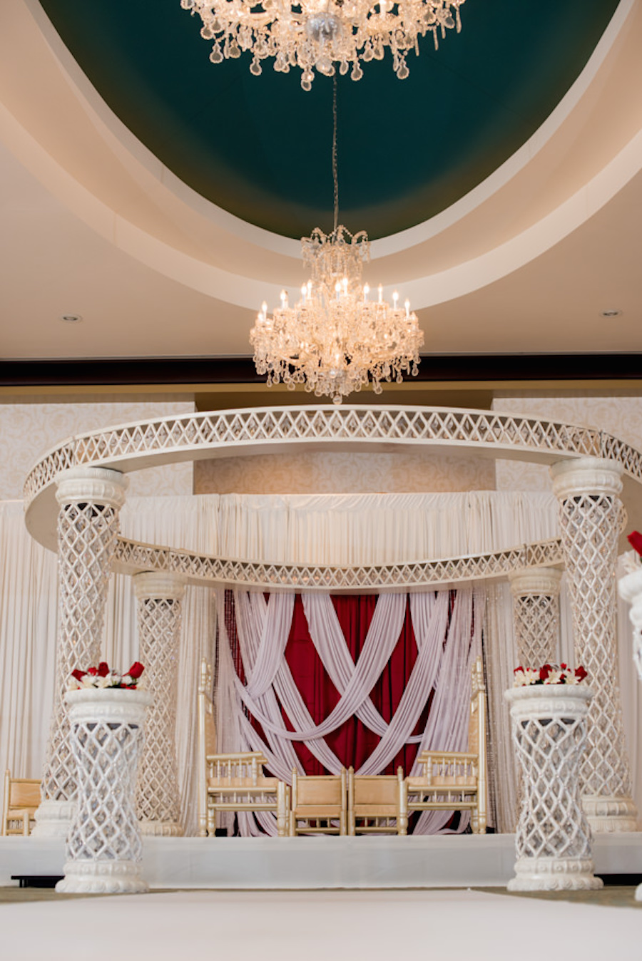 Wedding Ceremony with White and Red Altar and Floral Décor at Tampa Bay Wedding Venue, The Palmetto Club at Fishhawk Ranch