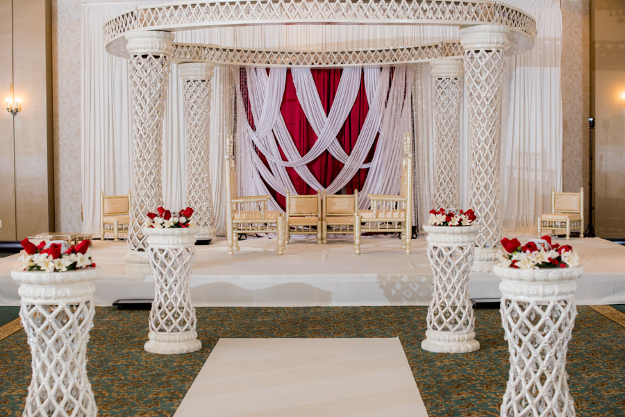 Indian Wedding Ceremony with White and Red Altar and Floral Décor at Tampa Bay Wedding Venue, The Palmetto Club at Fishhawk Ranch