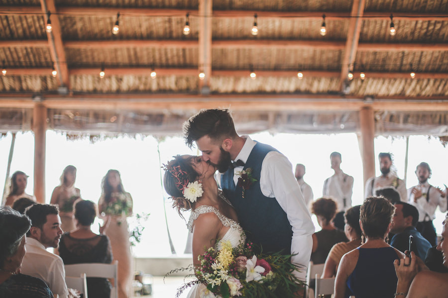 Bride and Groom Kissing at St. Pete Wedding Ceremony