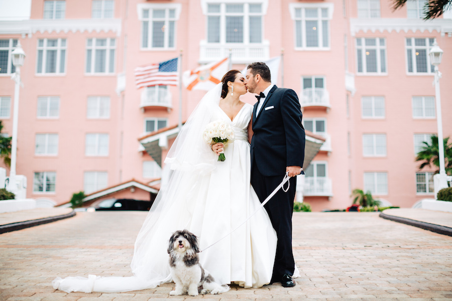Bride and Groom Wedding Portrait with Pet Dog at Tampa Bay Pet Friendly Wedding Venue Loews Don CeSar Hotel | Tampa Wedding Day Pet Care by FairyTail Pet Care