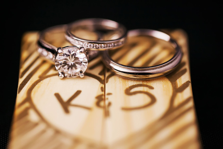 Bride and Groom Wedding Band and Engagement Ring Detail on Wooden Box with initials   St. Petersburg Wedding Photographer Limelight Photography