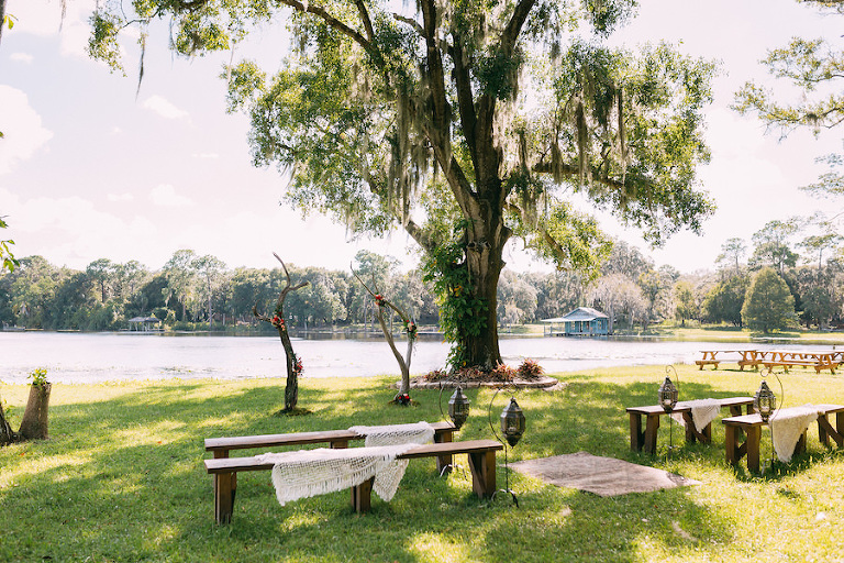 Boho Chic Wedding Ceremony with Bench Seating Waterfront Lake Backdrop | Rustic Tampa Bay Wedding Venue The Barn at Crescent Lake at Old McMicky's Farm