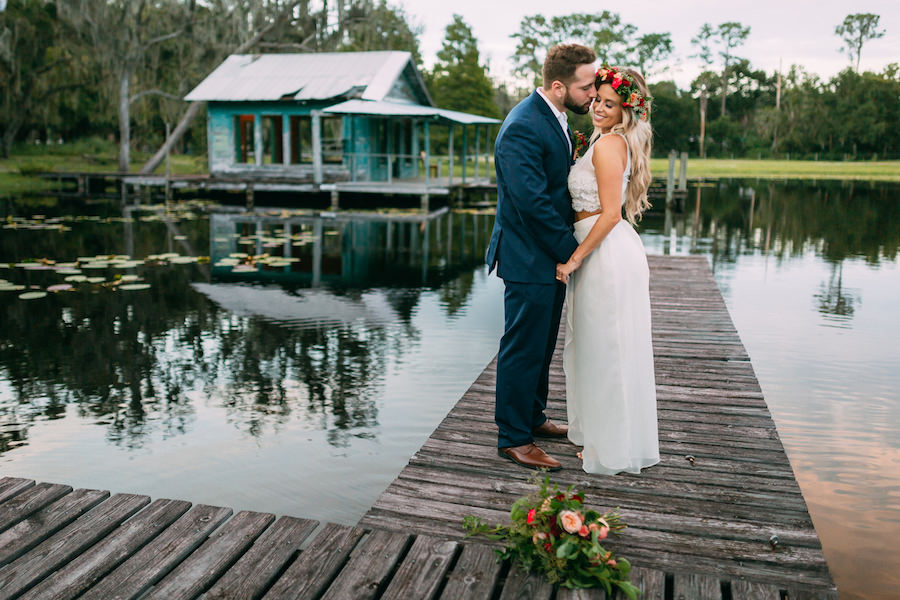 Boho Chic Wedding Portrait with Flower Crown and Waterfront Lake Backdrop Rustic Tampa Bay Wedding Venue The Barn at Crescent Lake at Old McMicky's Farm