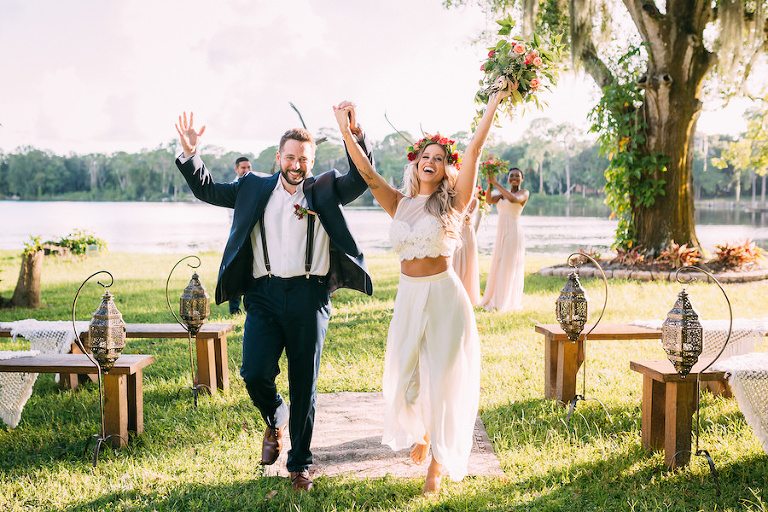 Outdoor Tampa Wedding Ceremony Portrait of Bride and Groom in Two Piece Wedding Dress | Outdoor Tampa Bay Lakefront Wedding Venue The Barn at Crescent Lake | Waterfront Wedding Ceremony with Farm Benches from Ever After Vintage Weddings