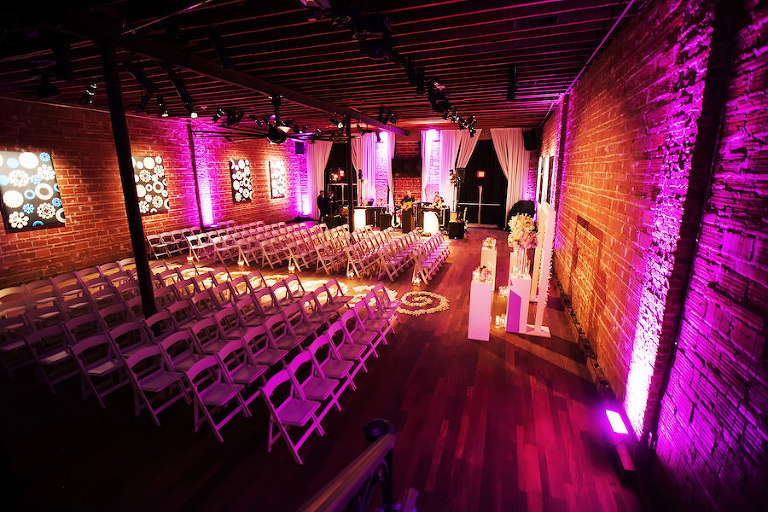Indoor, St Petersburg Wedding Ceremony with Exposed Brick Walls and Purple Uplighting | St. Petersburg Wedding Venue NOVA 535